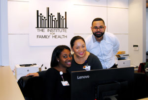 Health Center Staff Smiling at Front Desk