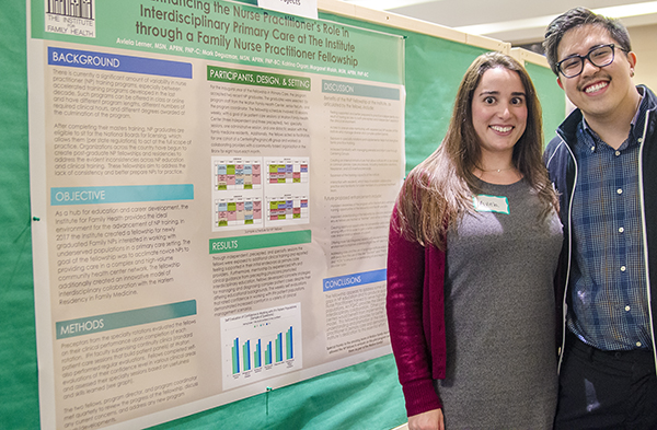 Nurse Practitioner fellows pose with their research project.