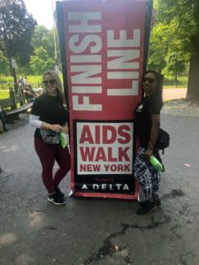 """Women standing next to """"Finish line"""" sign."""